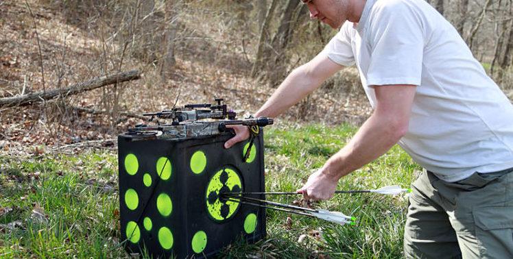 kneeling-pulling-arrows-from-target
