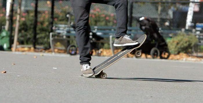 Tre flip (360 flips) on a Skateboard